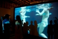 viewers-on-mimetic-stage-interacting-with-silouettes-and-video